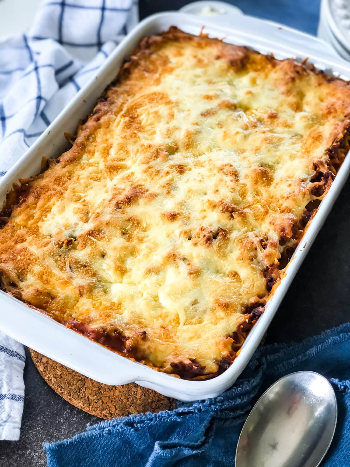 A dish of lasagna with a golden cheese crust.