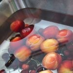 A sink full of Fruit and Vegetables soaking in a veggie wash