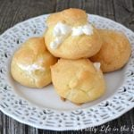 A plate of Cream Puffs filled with whipping cream