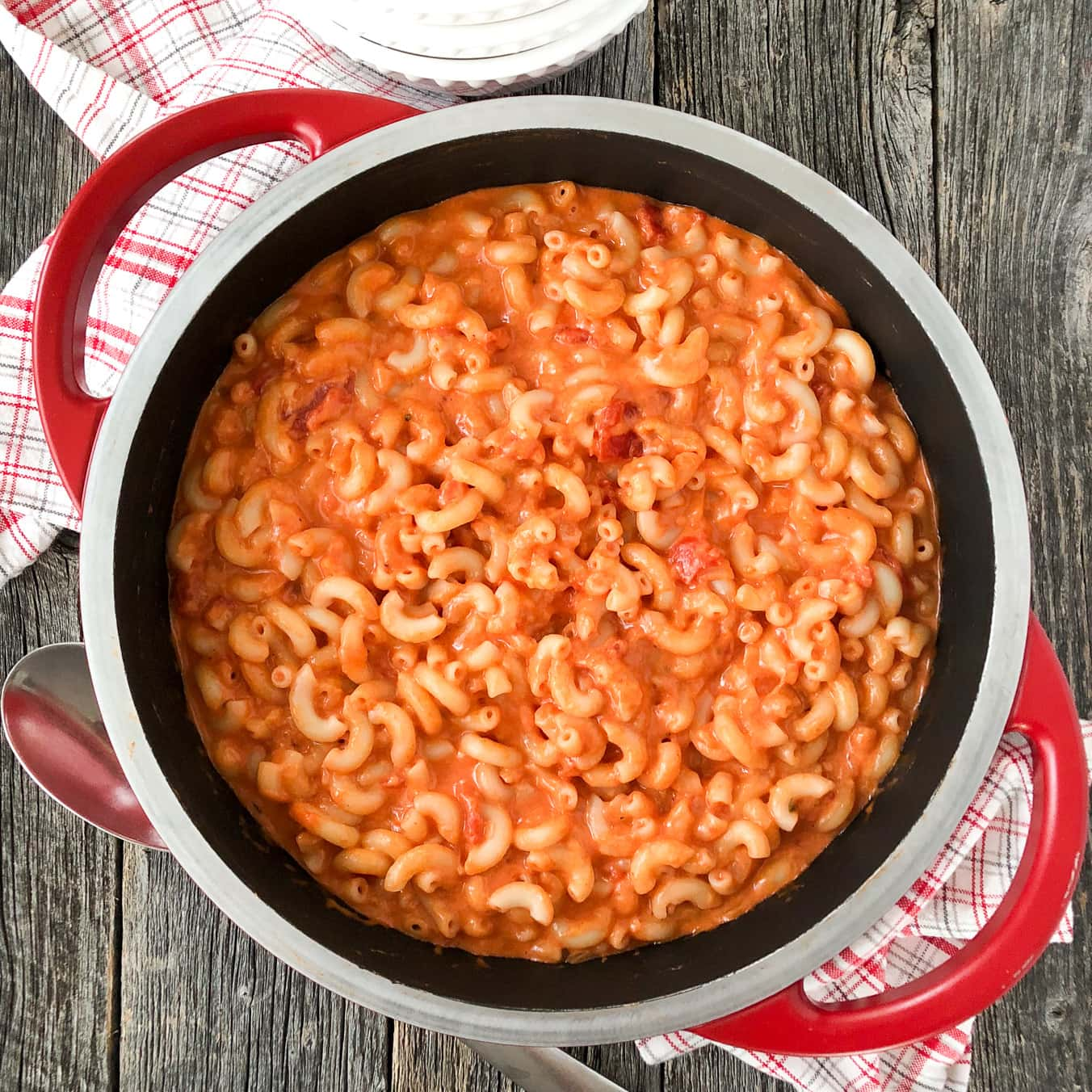 Simple Ways to Stretch Your Meals: Add drained canned tomatoes to mac and cheese.