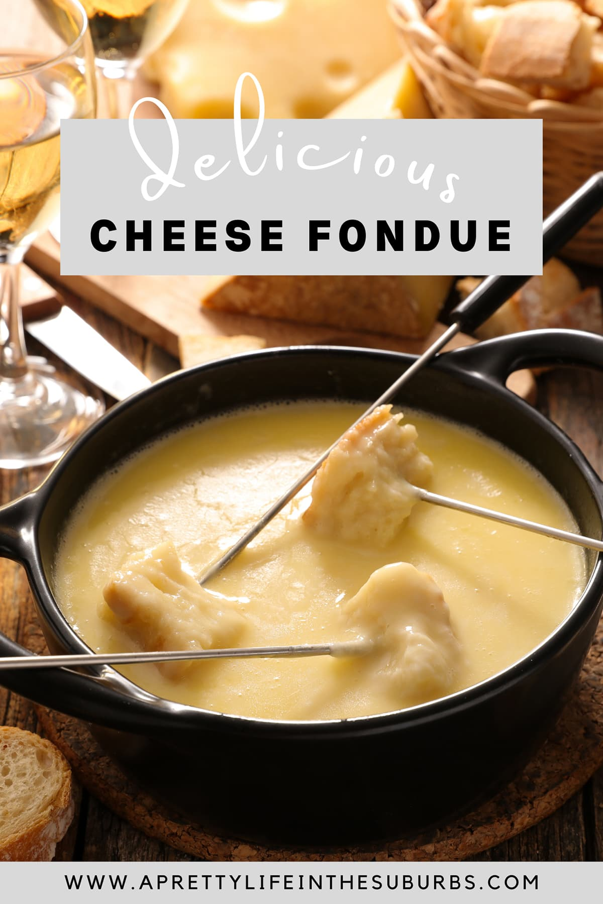 three forks with bread dipped in cheese fondue