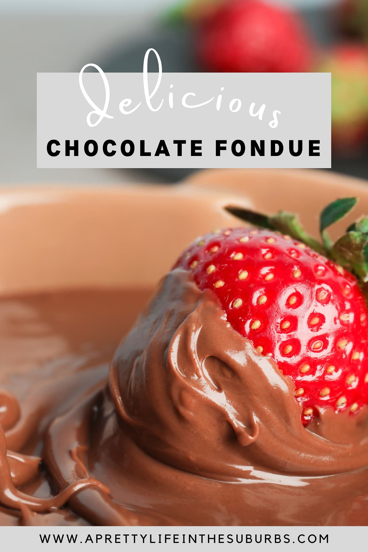 a strawberry dipped in chocolate fondue
