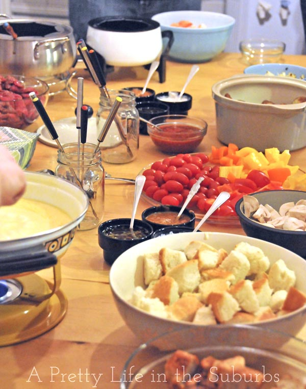 a fondue of cheese, meat an seafood, chocolate, with dips, sauces and dipper ideas!