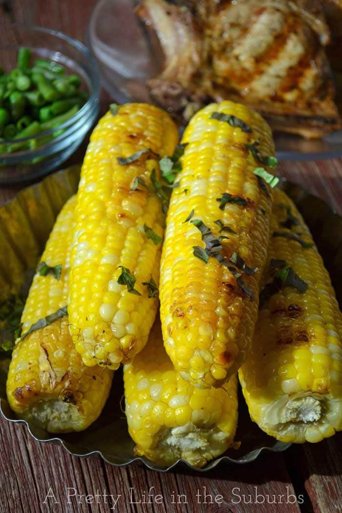 Basil Butter Roasted Corn on the Cob {A Pretty Life}