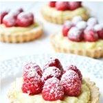 Raspberry & Vanilla Cream Tarts dusted with icing sugar