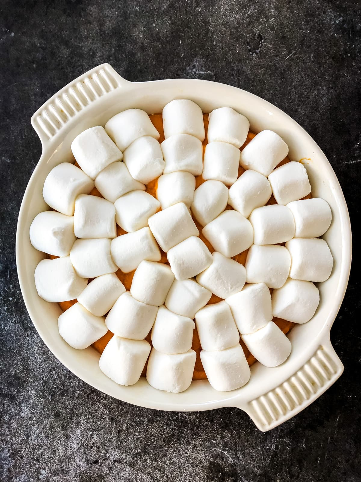 A top down view of Sweet Potato Casserole covered in marshmallows