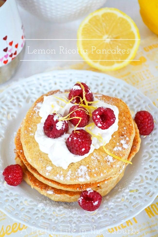 Lemon Ricotta Pancakes with whipped cream and fresh berries!