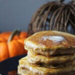 A stack of Pumpkin Pie Pancakes with melted butter