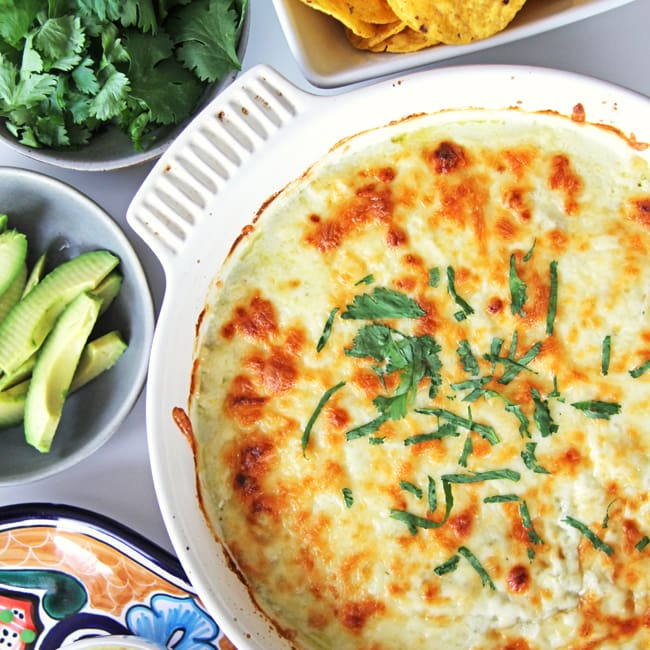 A dish of Easy Green Chile Chicken Enchilada Casserole right out of the oven.