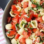 A serving bowl of Bruschetta Pasta Salad