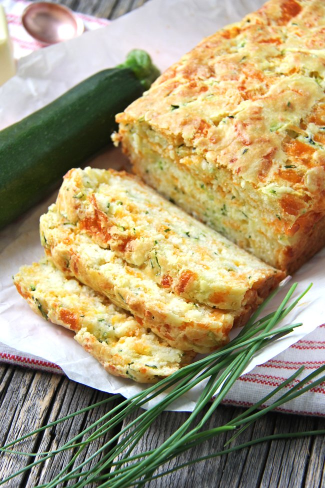 A loaf of sliced Zucchini, Cheddar and Chive Buttermilk Quick Bread