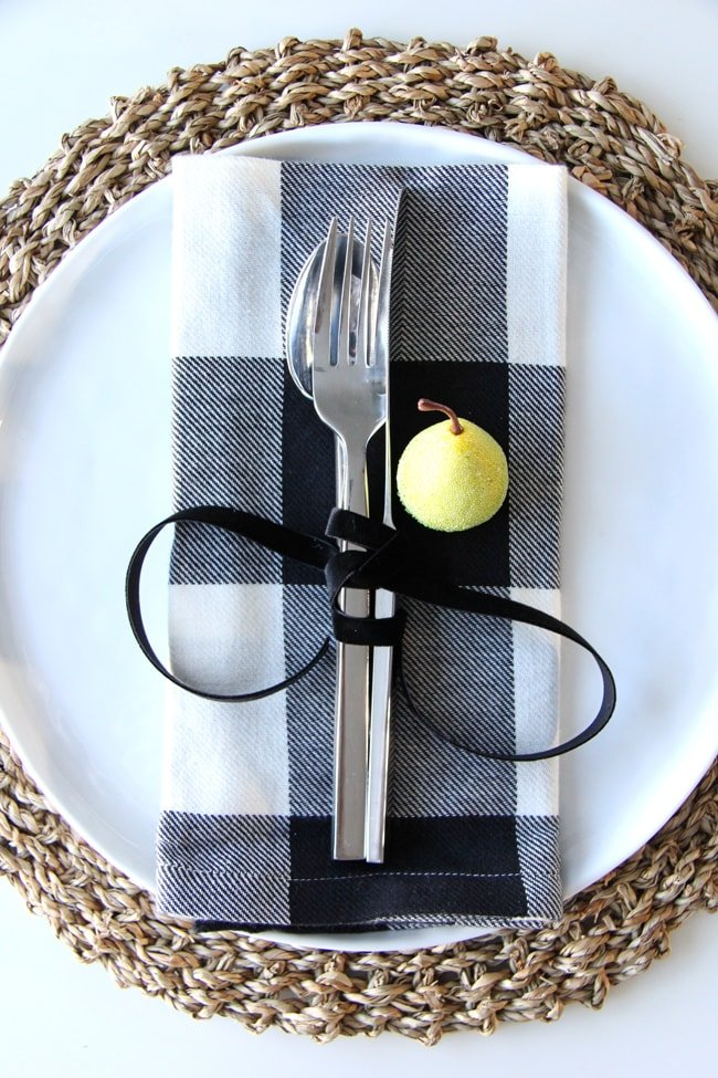 Christmas Place Setting Idea with pretty black velvet ribbon around the cutlery.
