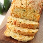 Sliced Jalapeno Cheddar Buttermilk Quick Bread on a cutting board