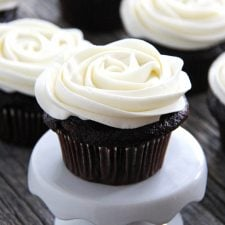 A chocolate cupcake decorated with Marshmallow Vanilla Buttercream