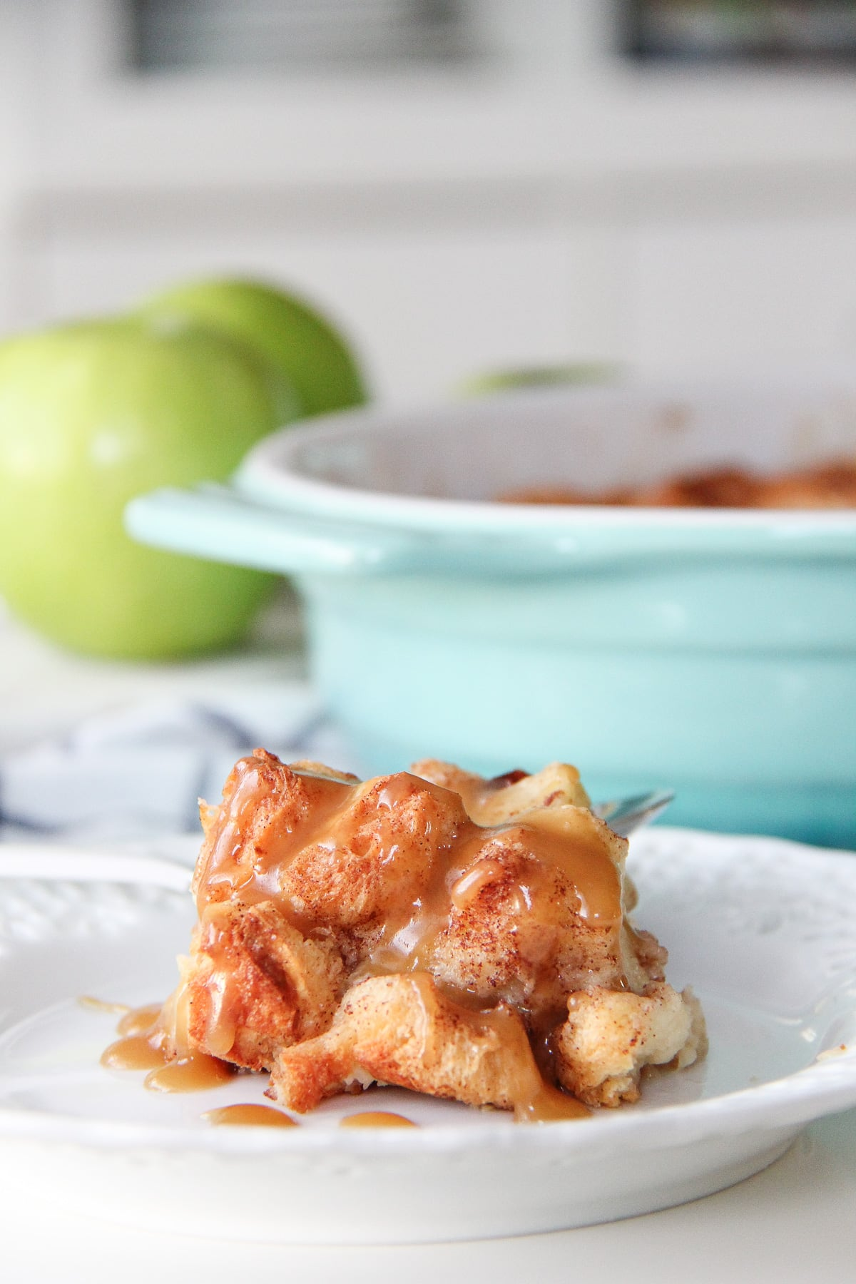 A side view of a plate of Apple French Toast drizzled with caramel
