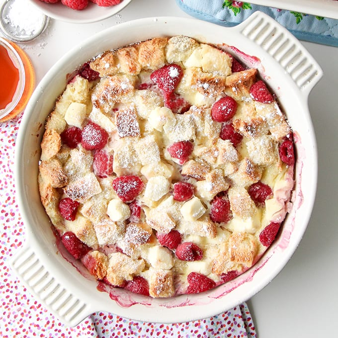 A dish of freshly baked Raspberry Baked French Toast, dusted with icing sugar