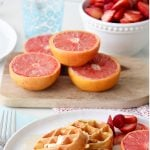 A plate of Eggless Waffles and fresh fruit