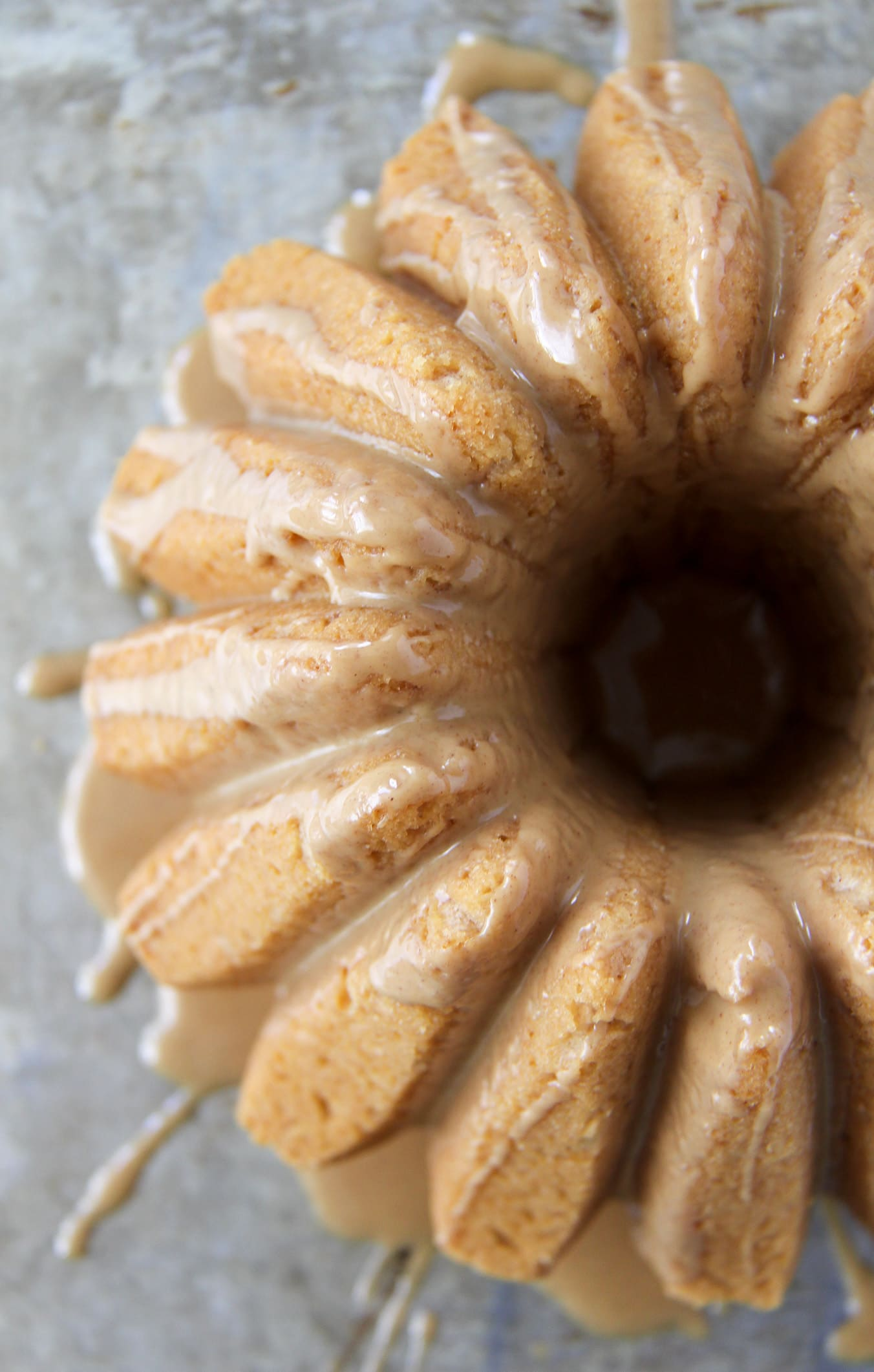 A close up view of a Peanut Butter Bundt Cake with Peanut Butter Drizzle