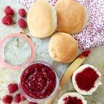 A pot of 2 Ingredient Raspberry Jam with buns