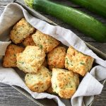 A basket of freshly baked Zucchini Cheddar Biscuits