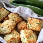 A basket of freshly baked Zucchini Cheddar Buttermilk Biscuits
