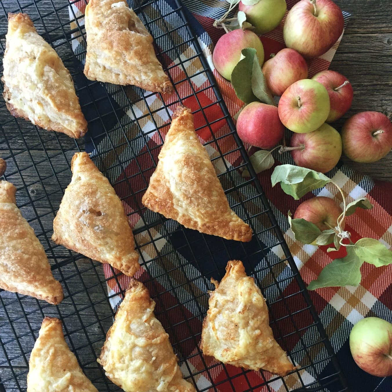 A cooling rack with apple turnovers