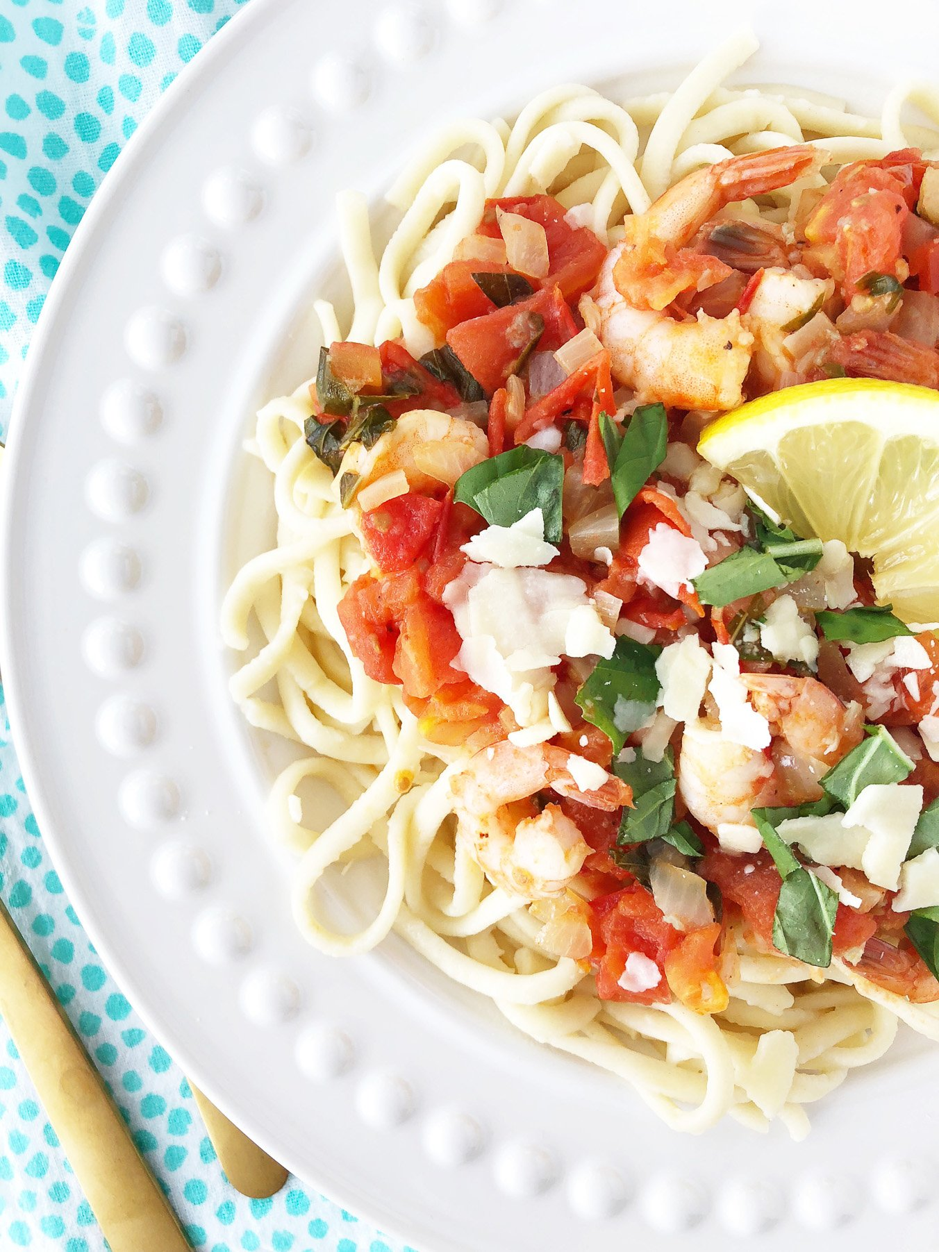 a top down view of pasta with a Tomato sauce and Shrimp