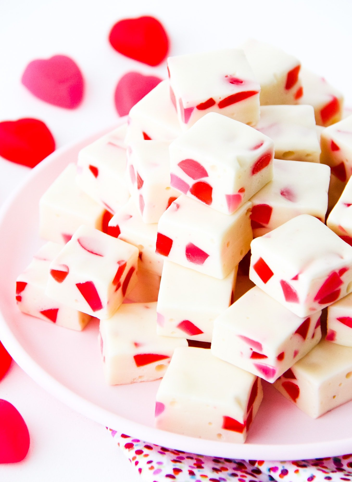 a plate of squares of nougat with red and pink gumdrops