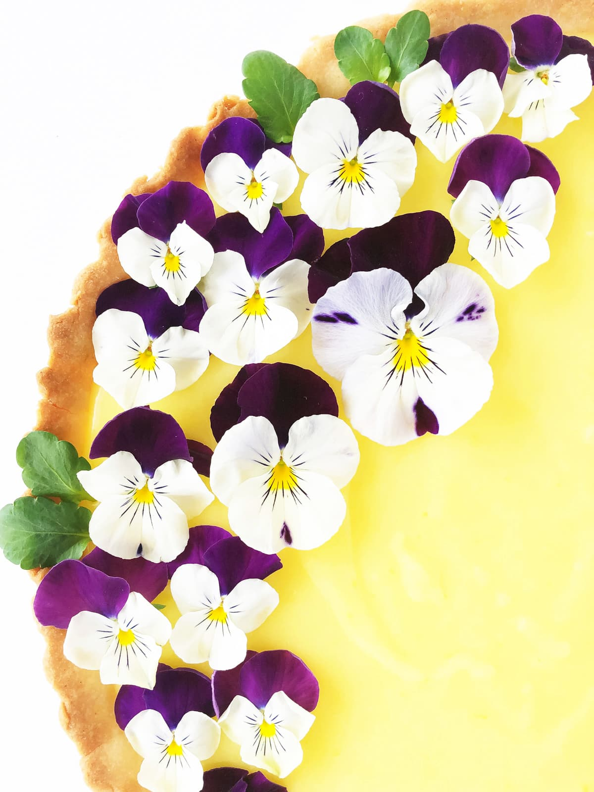 a Lemon Tart with a Shortbread Cookie Crust, garnished with Pansies