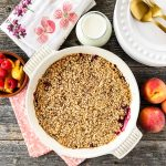 A dish of freshly baked Peach and Raspberry Fruit Crisp