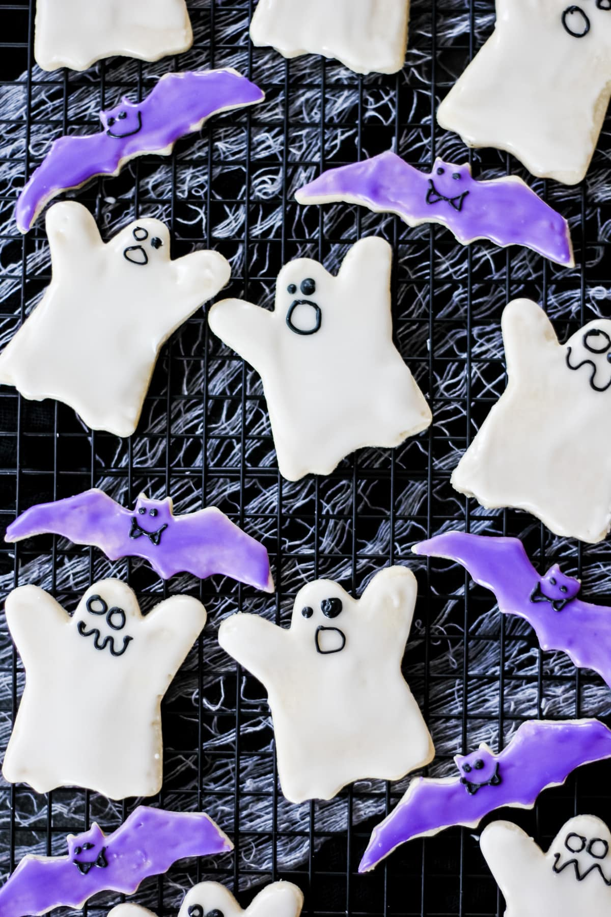 A tray of decorated Bat and Ghost Halloween Cookies
