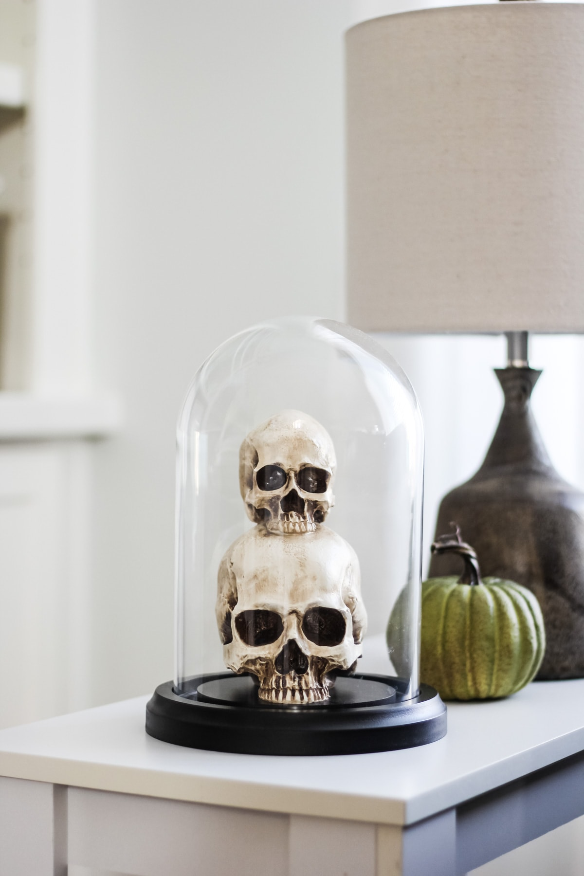 Love the skulls under the cloche!