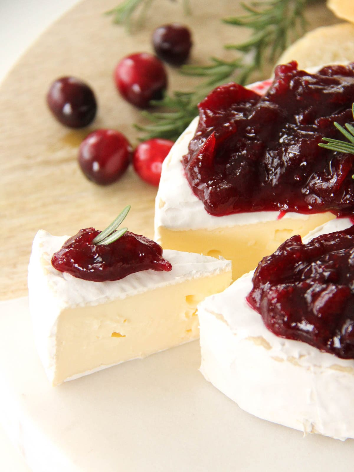 a slice of brie with a dollop of Cranberry Balsamic Chutney on top
