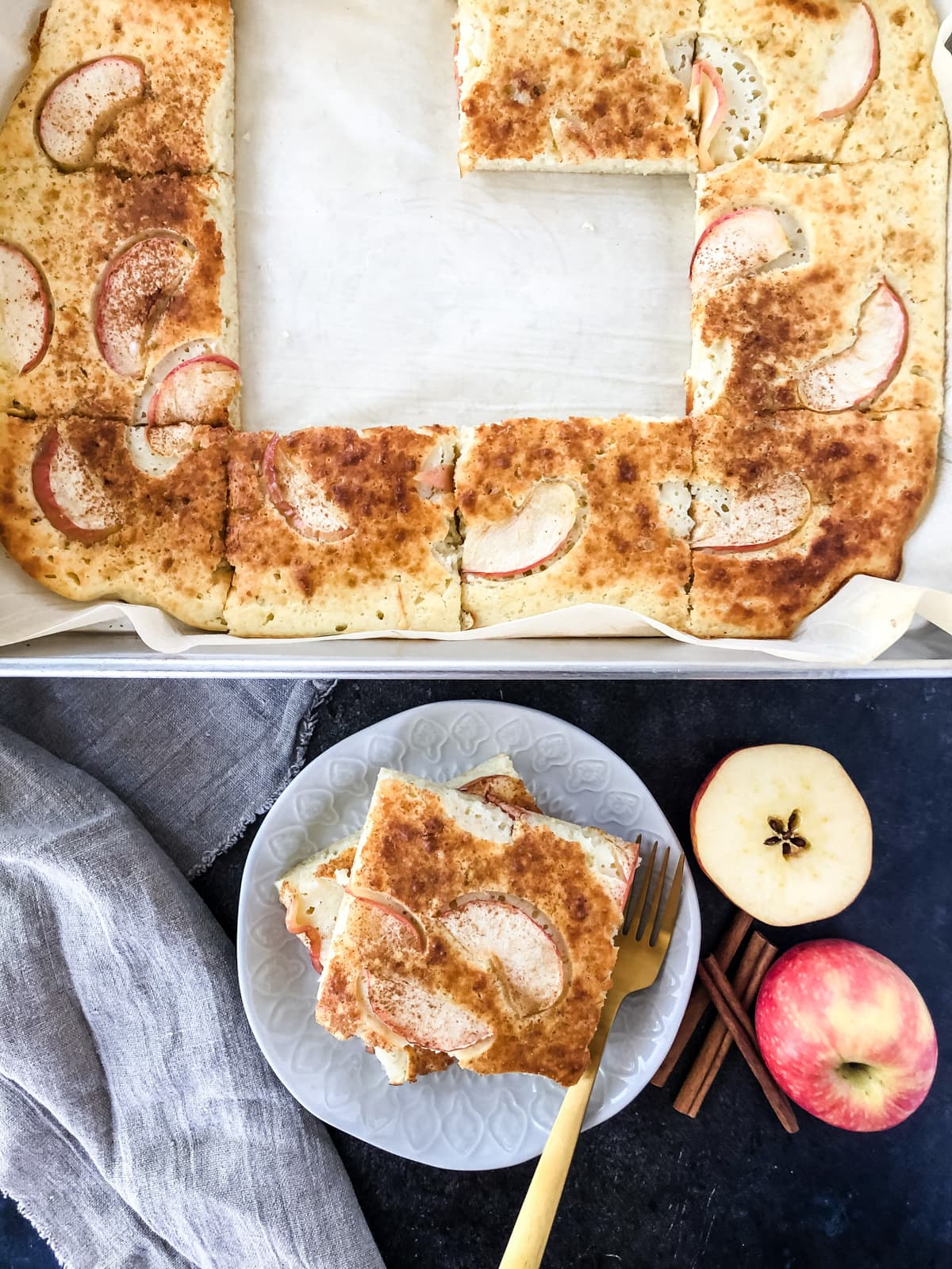 A pan of fresh baked Apple Pie Sheet Pan Pancakes, cut up and ready to serve.