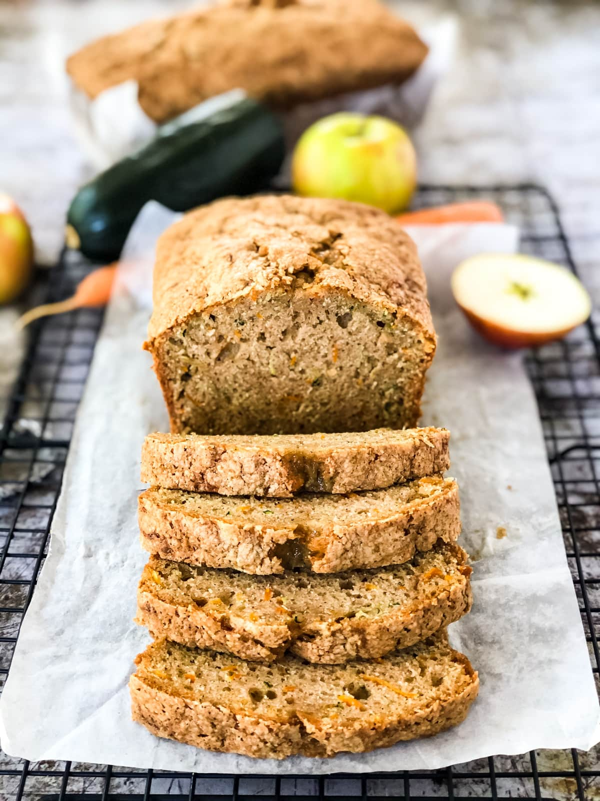A front view of a loaf of Carrot Zucchini Apple Bread cut into slices.