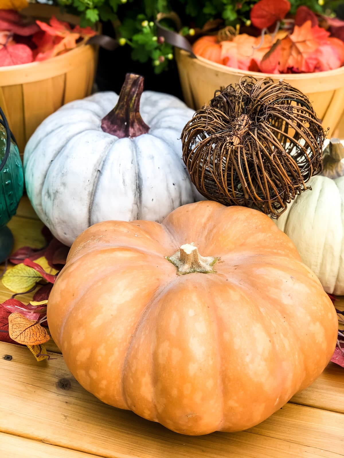 An arrangement of white and orange pumpkins