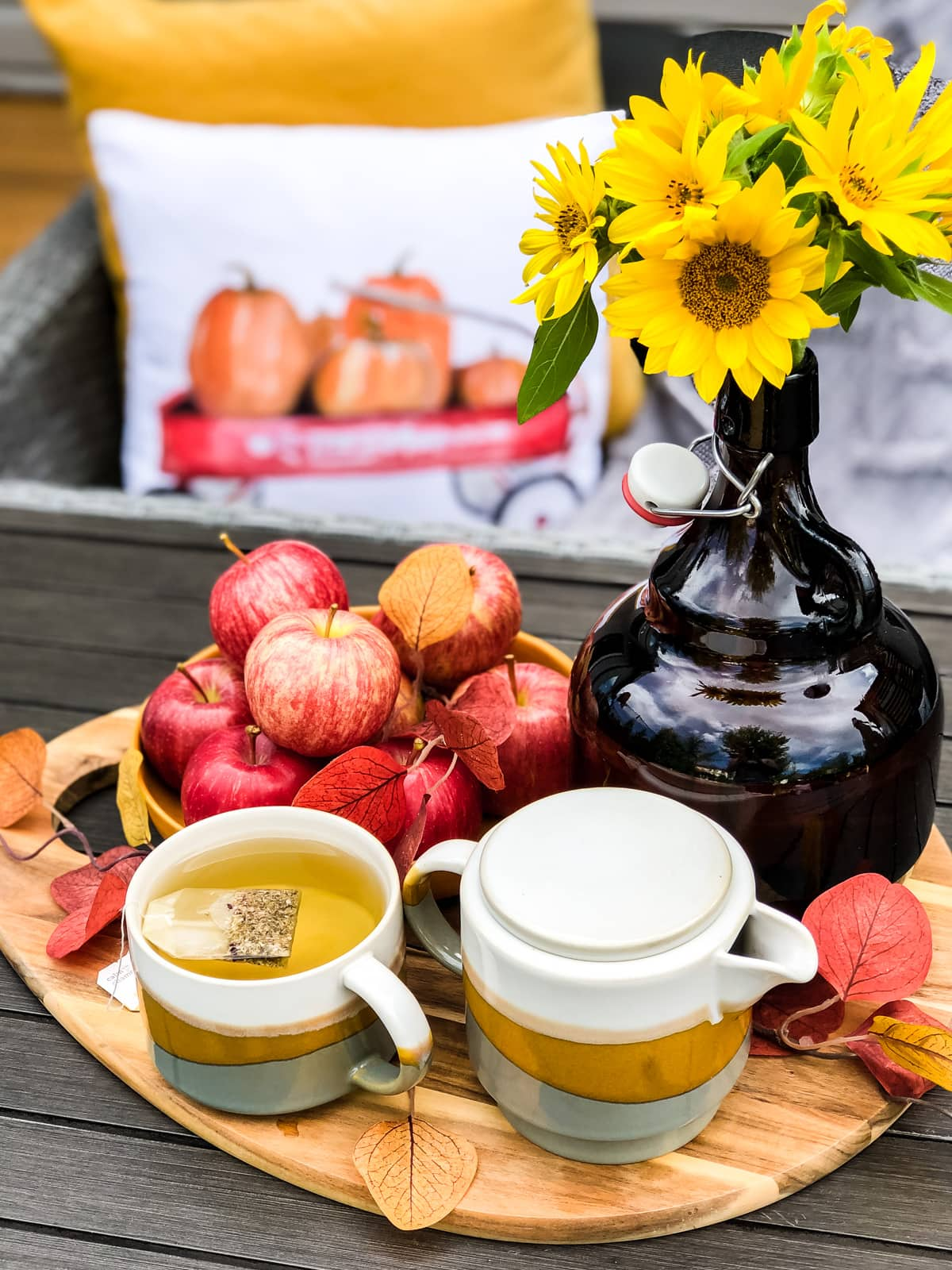 Apples, sunflowers and a tea cup