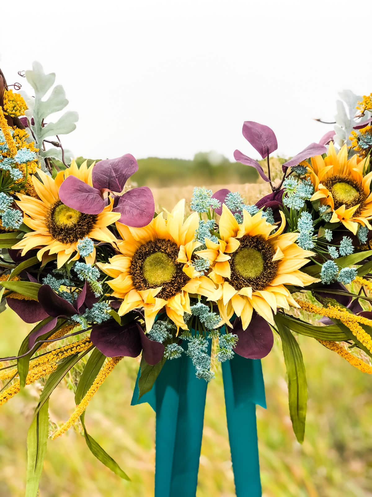 A close-up of the sunflowers at the base of the fall wreath