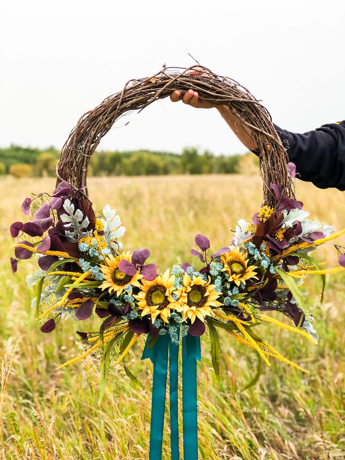 A picture of a wreath being held in a field