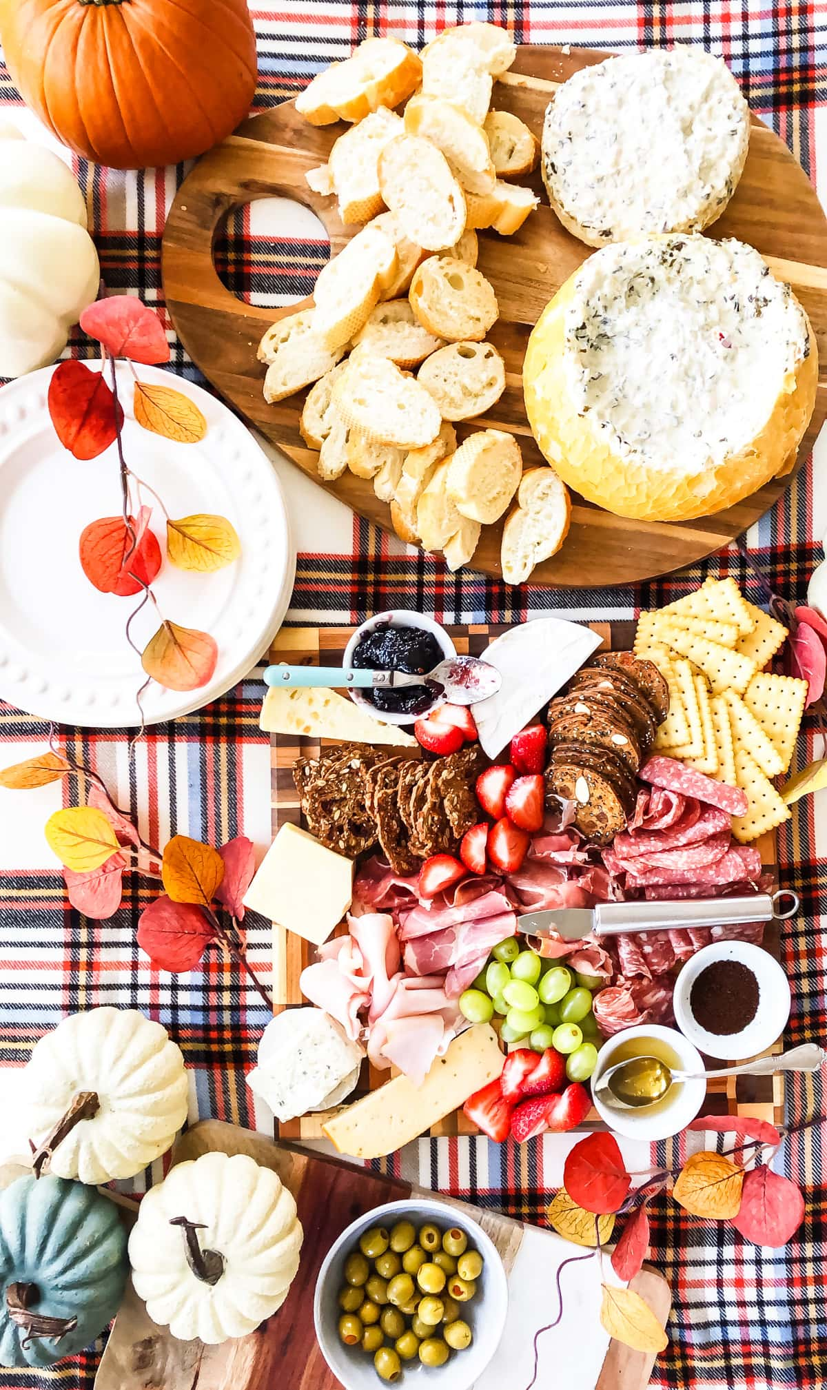 A top down view of a table full of delicious charcuterie, appetizers, dips and fruit