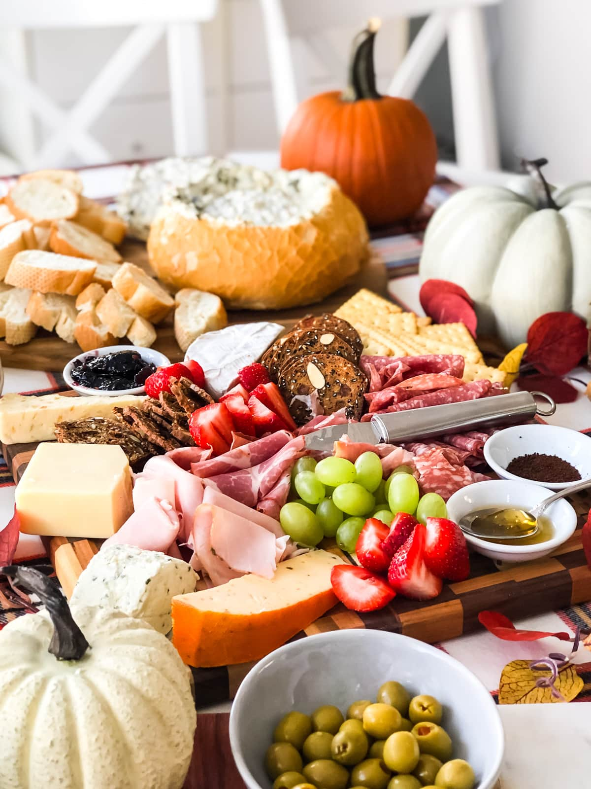 A table full of charcuterie, fruit and appetizers