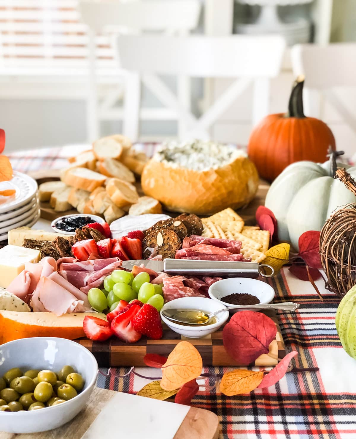 A table full of delicious charcuterie, appetizers, dips and fruit