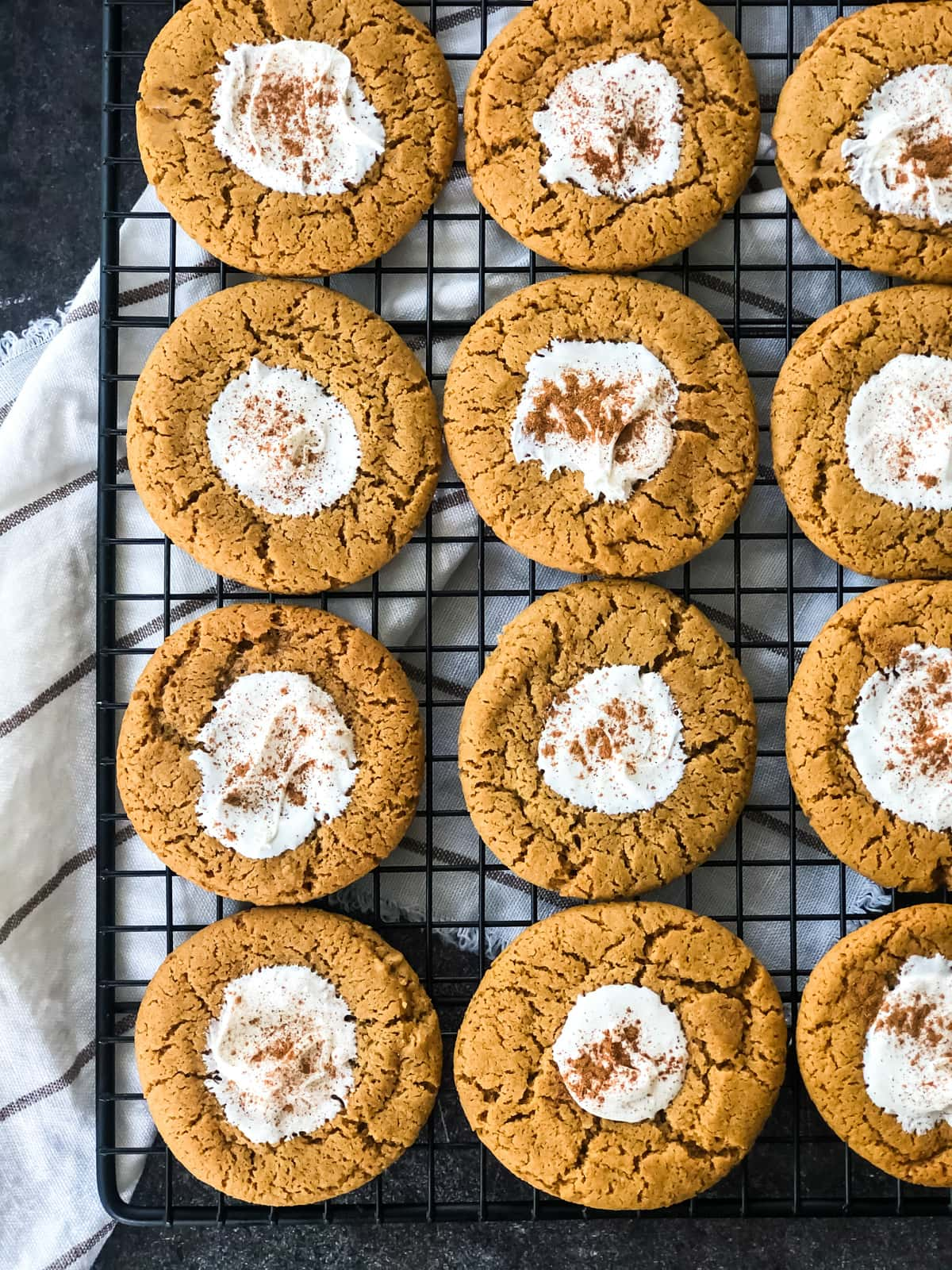 A tray of White Chocolate Ginger Thumbprints cooling on a cookie rack