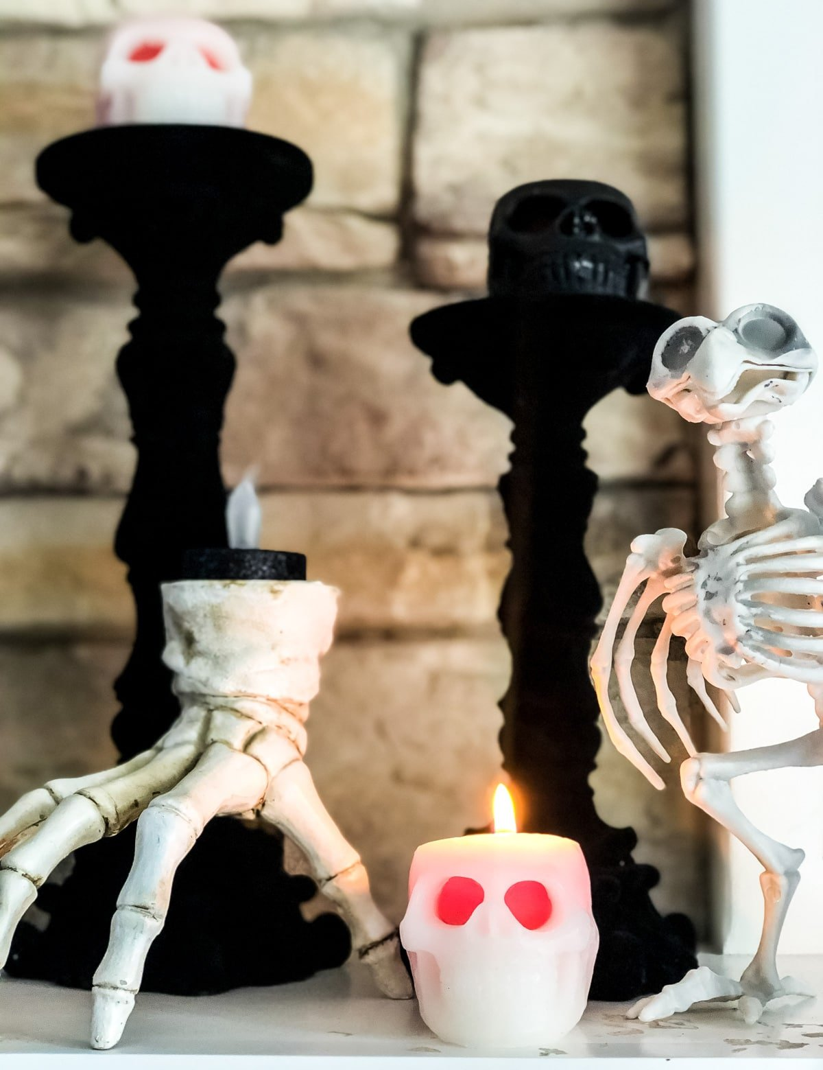 Skeleton candles on black candle sticks