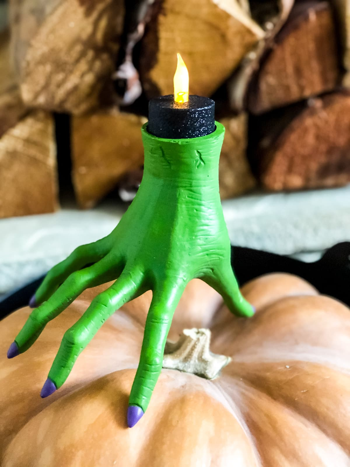 A green witch hand candle holder