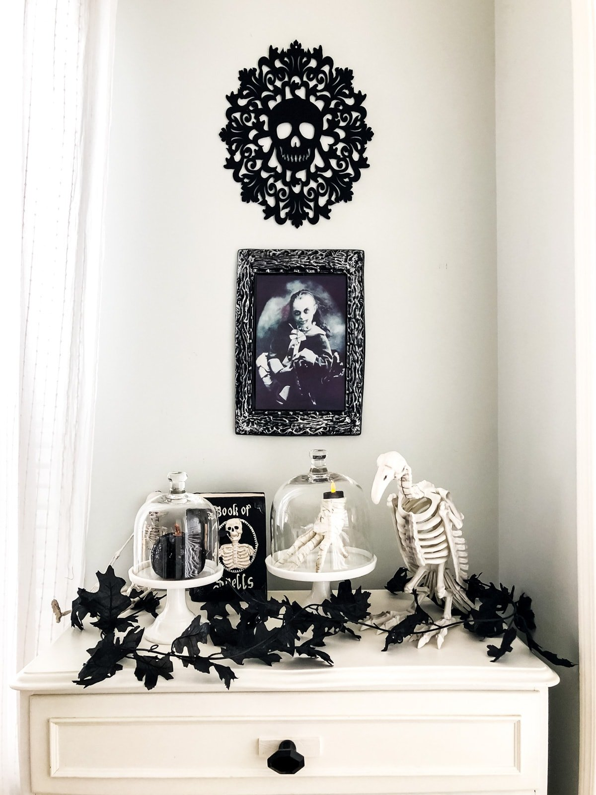 A Halloween vignette of skeletons and Halloween art