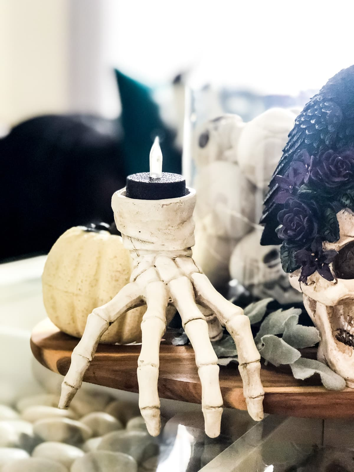 A skeleton hand candle holder