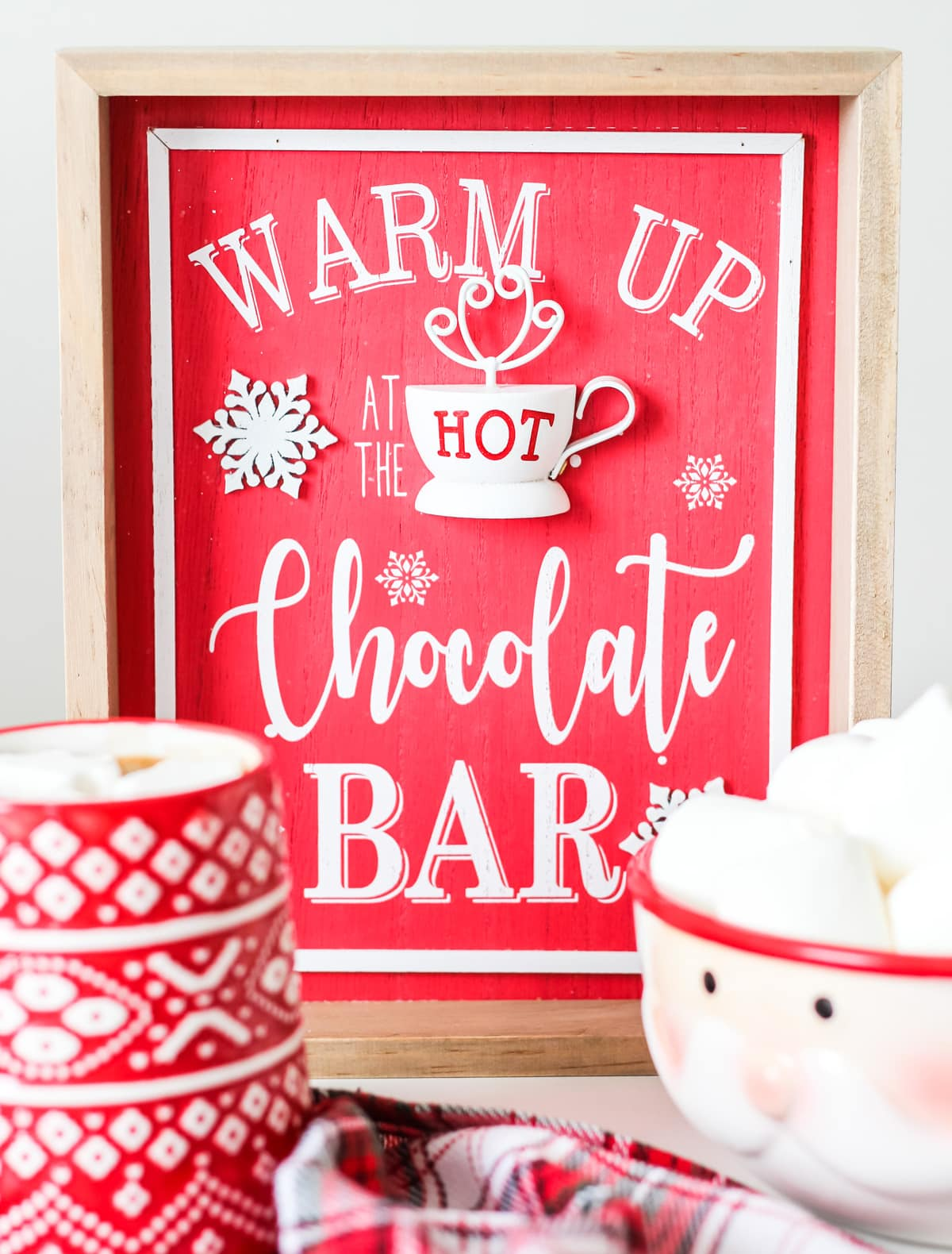 A red and white hot chocolate bar sign