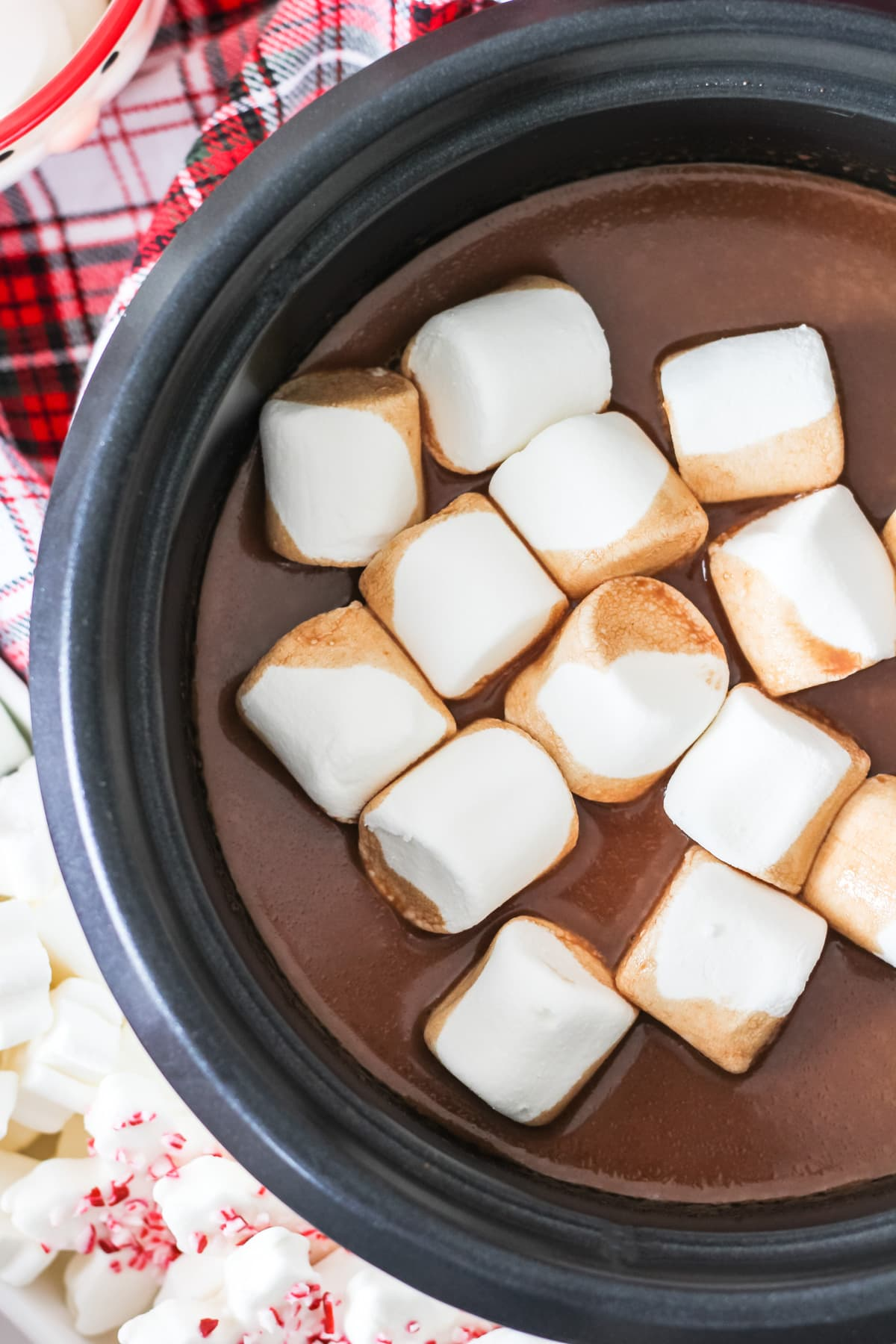 A top down view of a Slow Cooker of Hot Chocolate and marshmallows