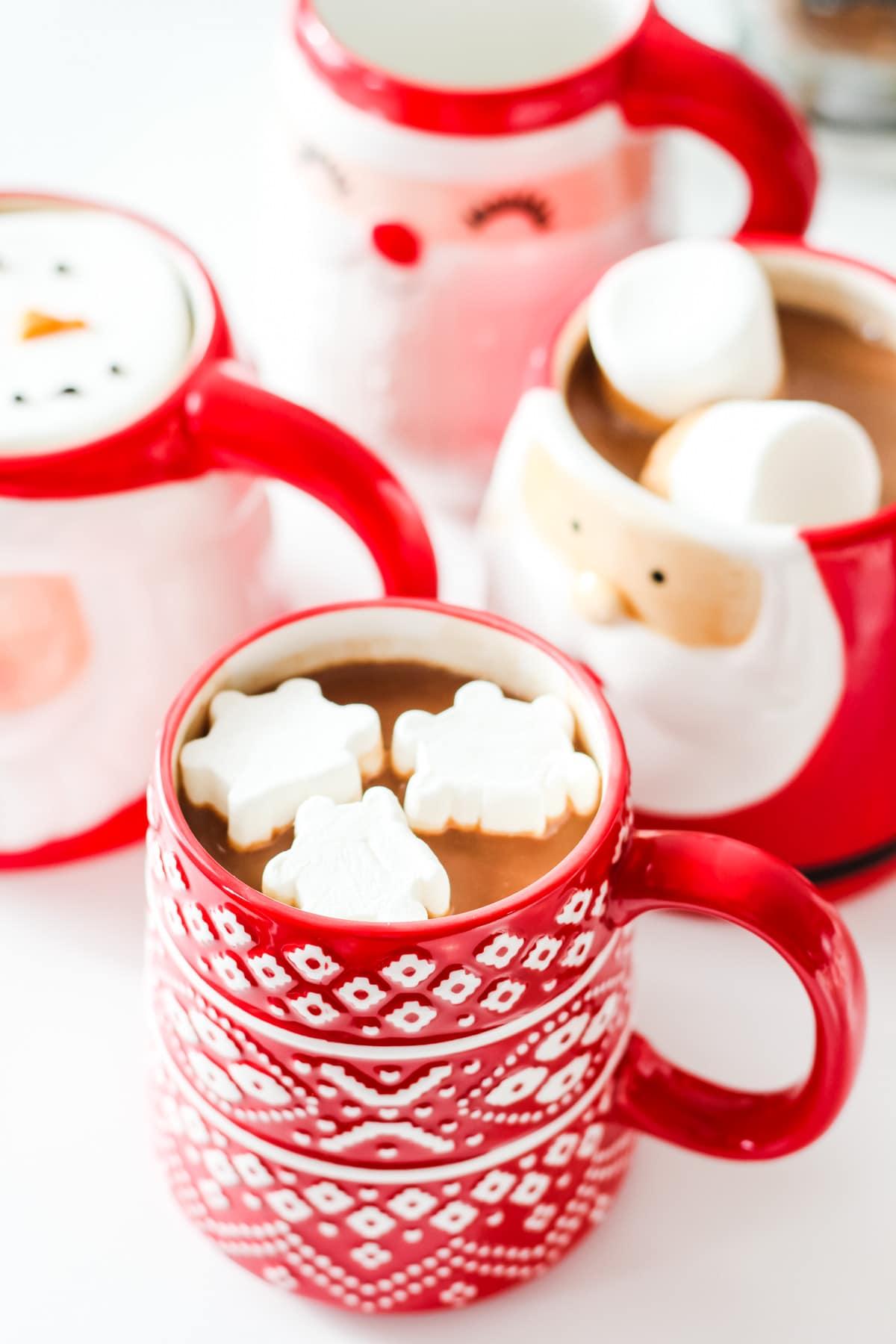 A mug of hot chocolate and snowflake marshmallows
